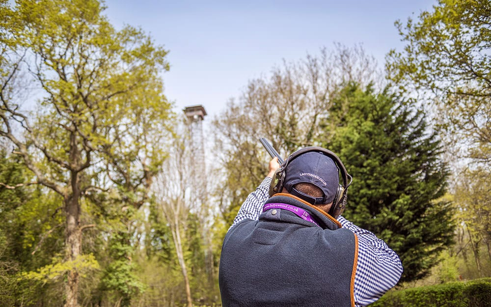 Clay pigeon shooting at Lady's Wood Shooting School in front of tower
