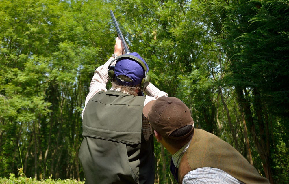 Clay pigeon shooting practice at Lady's Wood Shooting School
