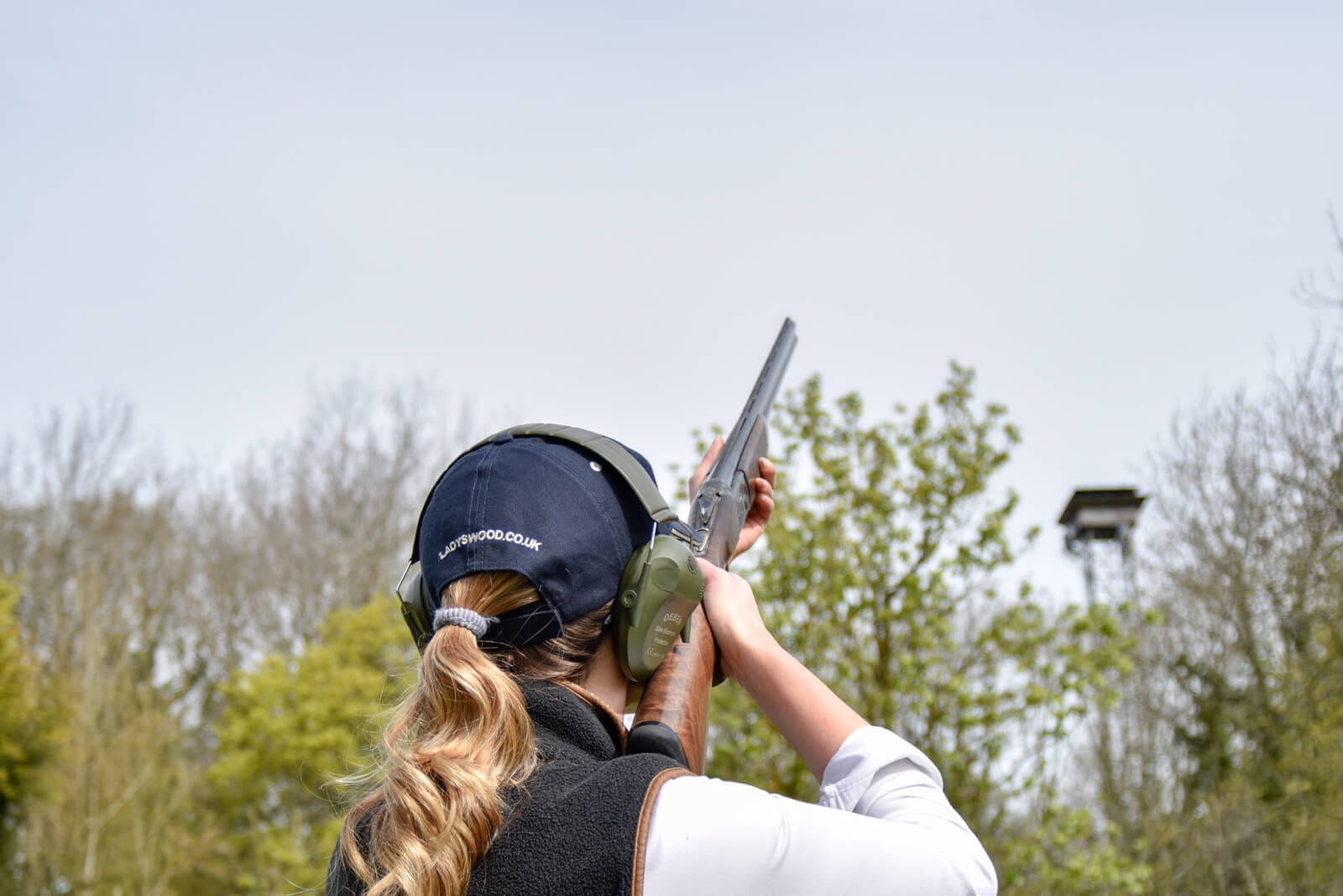 Aiming while clay pigeon shooting at Lady's Wood Shooting School