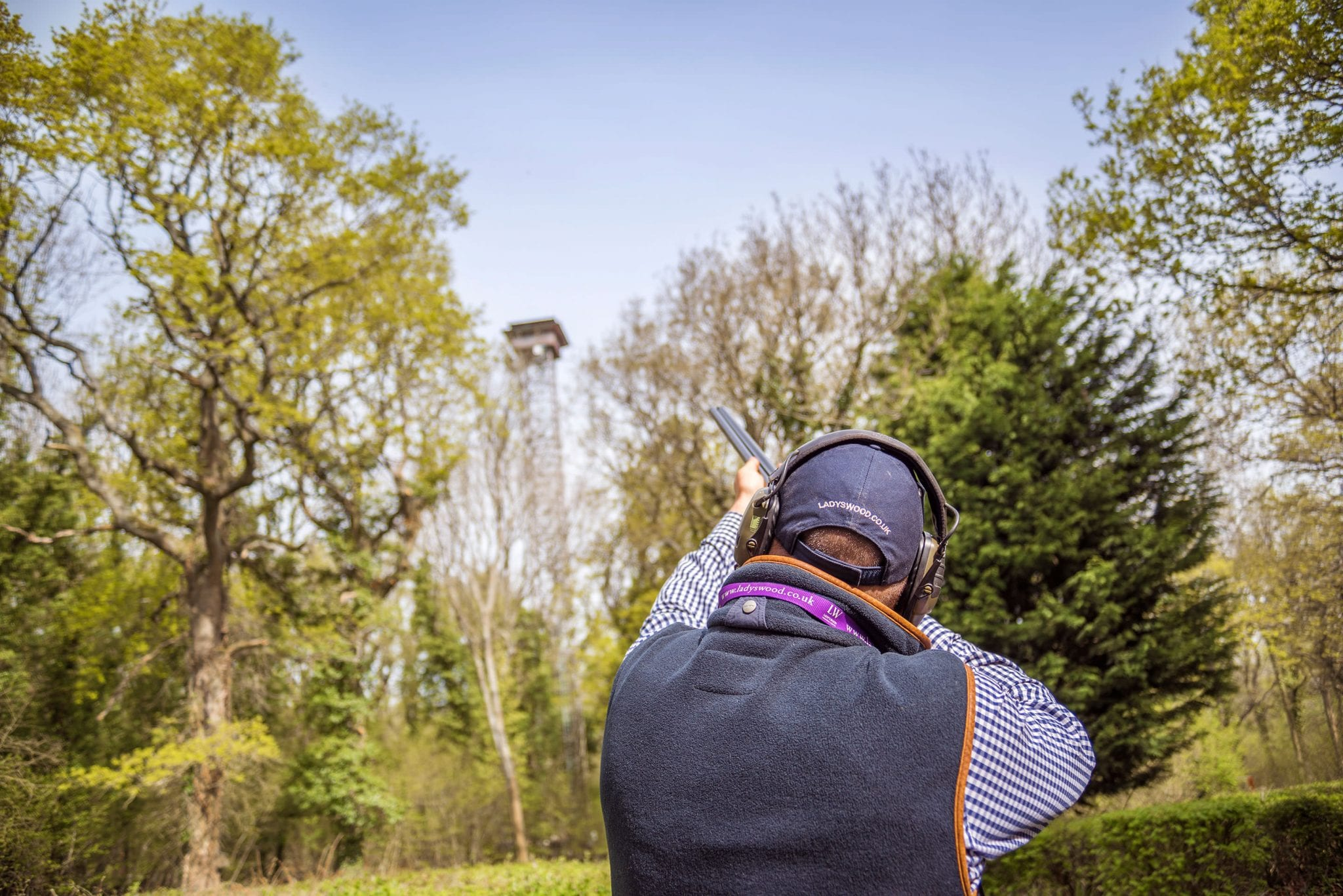 Clay shooting instruction in front of the tower at Lady's Wood Shooting School