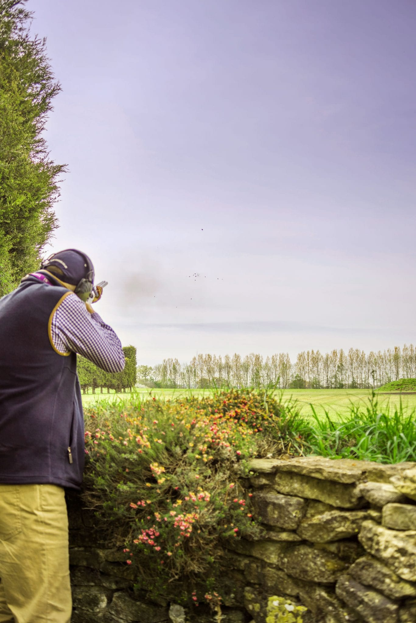 Hitting a clay while clay pigeon shooting at Lady's Wood Shooting School