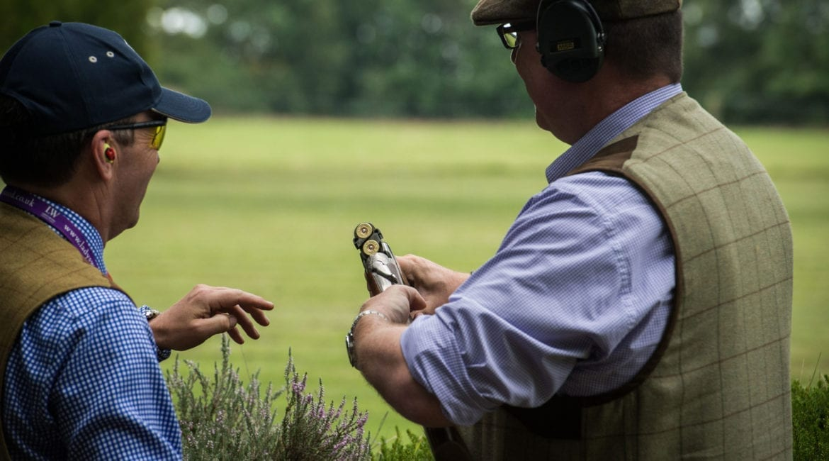 Charity shoots - Reloading a shotgun during practice for clay pigeon shooting at Lady's Wood Shooting School