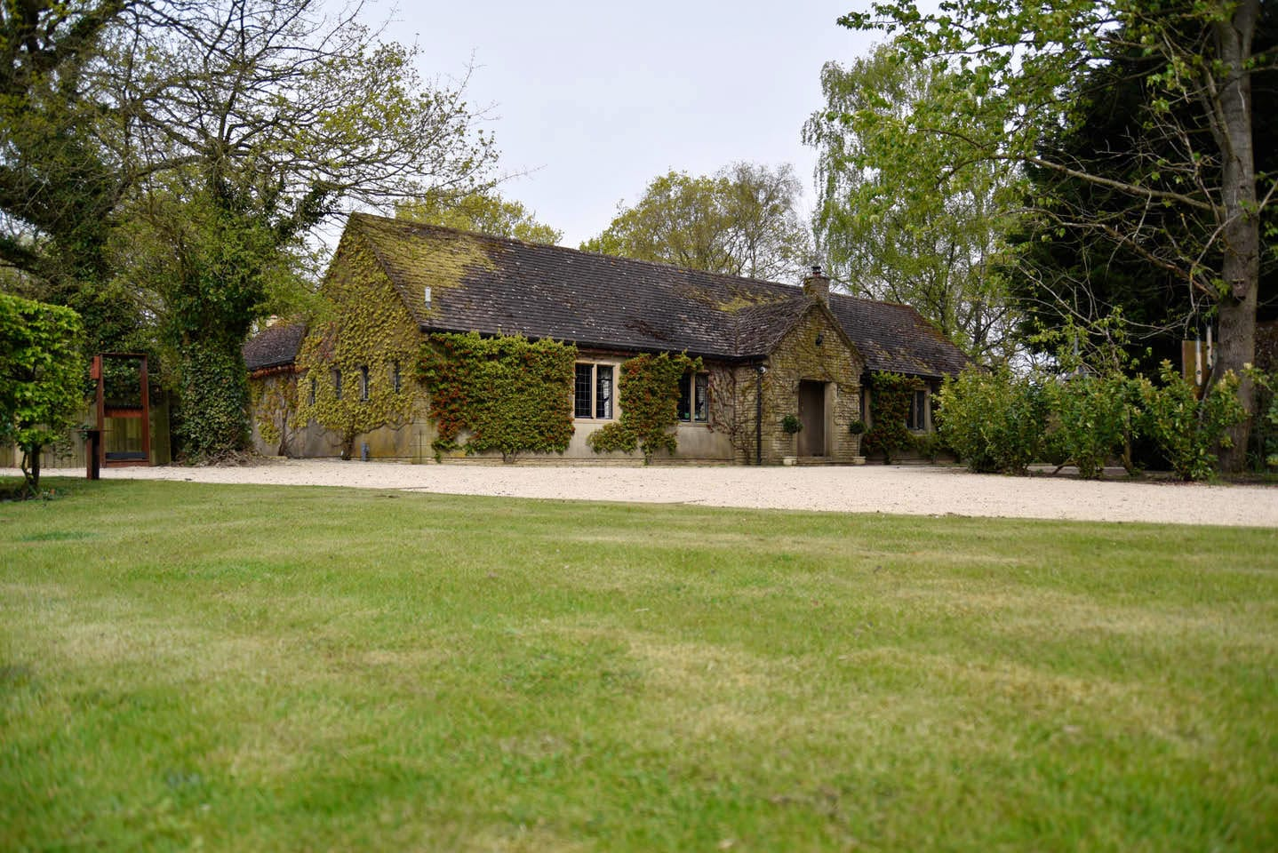 The house and grounds of Lady's Wood Shooting School