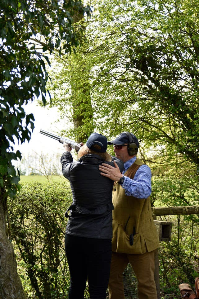 Guided instruction while clay pigeon shooting at Lady's Wood Shooting School