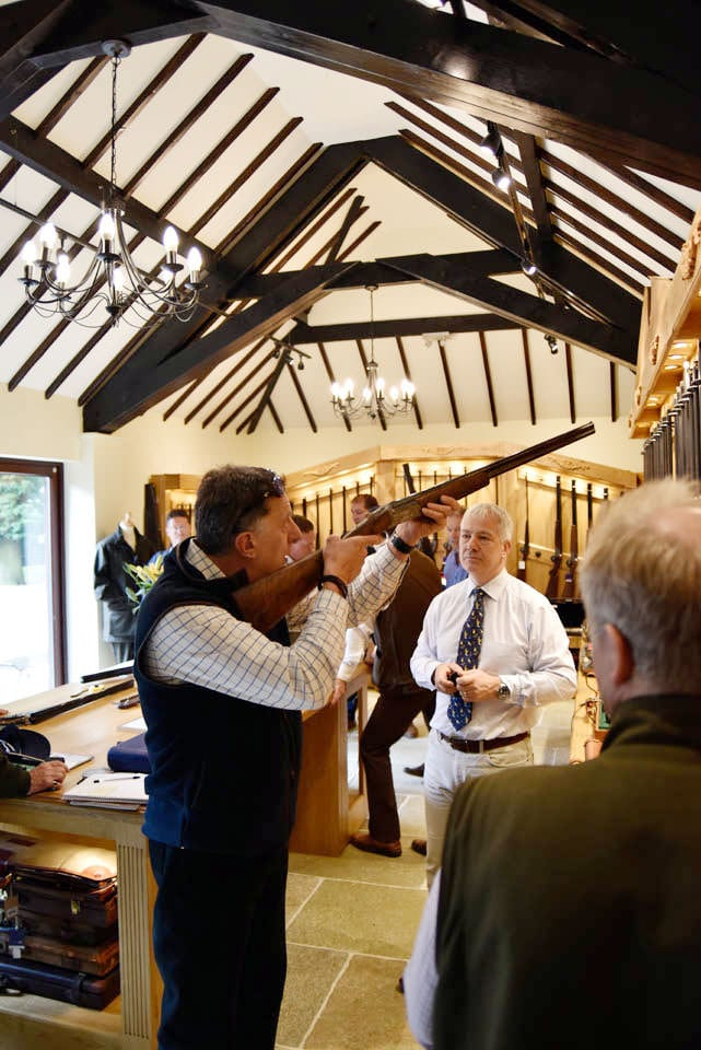 A customer trying a gun at the Sportarm at Lady's Wood Gun Room