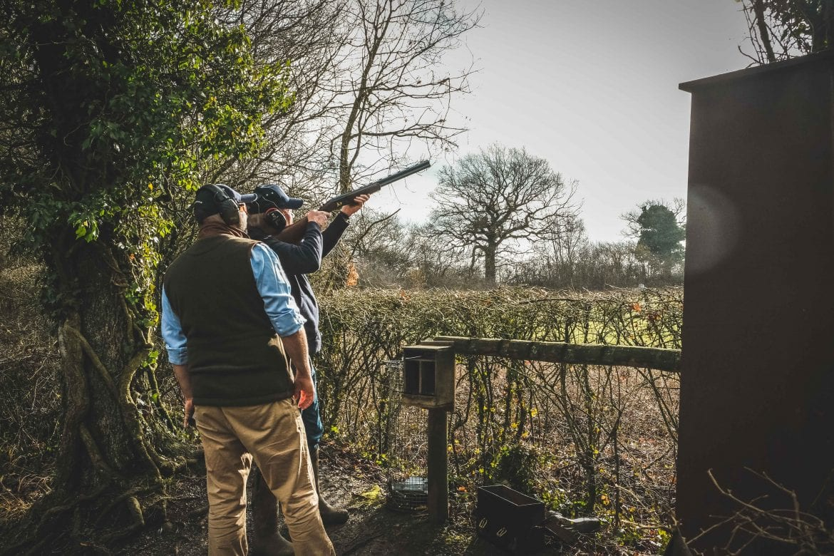 Shooting instructor Chris Hanks helps a customer learn to shoot