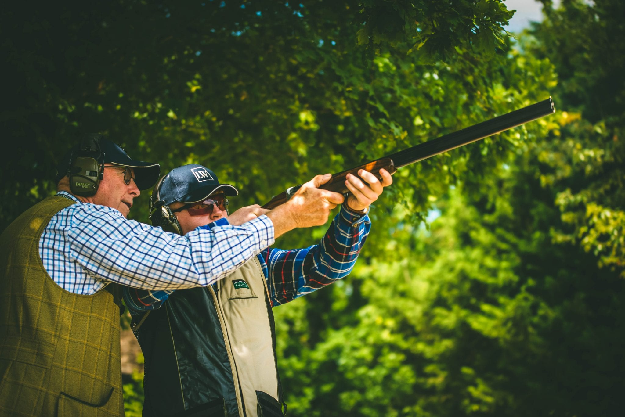 Lady's Wood owner and instructor Ernie Hemmings instructs a customer during a clay shooting lesson and helps him learn to shoot